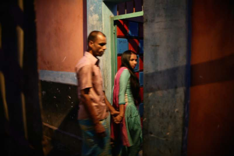 As evening falls Beauty enters her brothel with a regular customer or 'Babu'. © Souvid Datta – Sonagachi: Vanishing Girls
