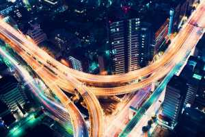 Aerial view of a massive highway intersection at night in Shinjuku, Tokyo, Japan. © Melpomene - Fotolia.com